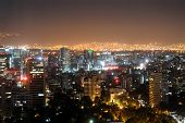 image of overpopulation  - Downtown Mexico City skyline at night - JPG