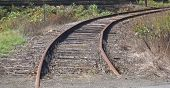 picture of train track  - a vintage track with a curve going around the bend - JPG
