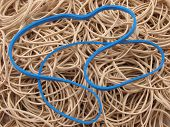 Pile Of Rubber Bands With Blue Band