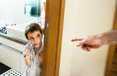 Naughty boy brushing his teeth poster