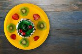 Dessert Cake With Kiwi And Strawberries On A Wooden Background poster