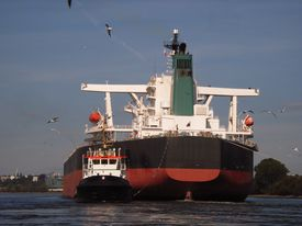 stock photo of iron ore  - Very large bulk carrier leaving a port  - JPG