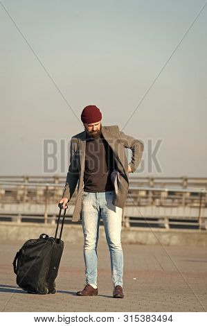 poster of Moving To New City Alone. Traveler With Suitcase Arrive Airport Railway Station Urban Background. Hi