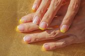 French Manicure. Girl Makes A Manicure. Yellow-pink Color Manicure With A Pattern poster