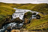 Iceland, Europe: Aerial View Of The Upper Fall Of Skogafoss Waterfall, The Famous Tourist Attraction poster