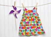 Baby Dress And Pinwheel On A Clothesline