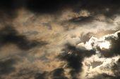 Sun peeking though clouds