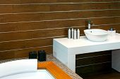 stock photo of lavabo  - Bathroom with wooden walls and modern basin  - JPG