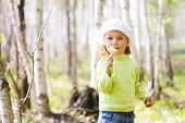 picture of cute little girl  - Girl with blowballs in spring birch forest - JPG