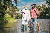 Fisherman And Trophy Trout. Fisherman Fishing With Spinning Reel. Fly Fishing For Trout. Fly Fisherm poster