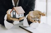 House Model And Key On Table For Finance And Banking Concept.home Purchase Mortgage Concept. poster
