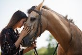 Tenderness, Love And Animals Concept. Sensual Young Woman Touching Horses Foretop, Close Eyes And Ge poster