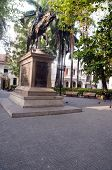 stock photo of bolivar  - Statue founder Simon Bolivar in Bolivar Park Plaza Mayor Cartagena de Indias Colombia - JPG