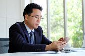 Asian Businessman Using Phone While Working At Office, Ceo Business Asian Man With Smart Phone For C poster