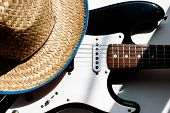 American Culture. Country Music Concept Theme With A Cowboy Hat And Electronic Guitar On A White Bac poster