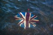 Broken Umbrella With Union Jack On It, Discarded In Shallow River. poster