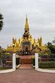 The Buddhism Golden Pagoda At Wat Pha That Luang Temple - Great Golden Stupa Or Pagoda. The Most Imp poster