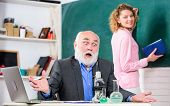 Teacher And Girl With Notepad Near Chalkboard. College University Education. Biologist Or Chemist Wi poster