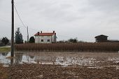 House With Flooded Field