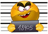 stock photo of emoticon  - Arrested emoticon with measuring scale in back holding his number posing for a criminal mug shot - JPG