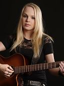 Attractive Female Playing Acoustic Guitar