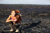 Hiker showing fresh cooled lava from Kilauea volcano around Hawaii volcanoes national park, Big Isla