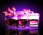 Image of three glasses of burning puple absinthe