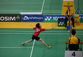 KUALA LUMPUR - JANUARY 15: Hong Kong's Cheung Ngan Yi returns during her qualifying match at the Maybank Malaysia Open 2013 Badminton event on January 15, 2013 in Kuala Lumpur, Malaysia.