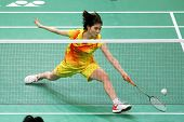 KUALA LUMPUR - JANUARY 15: China's Xuan Deng retrieves the shuttlecock during her qualifying match a