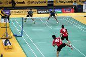 KUALA LUMPUR - JANUARY 15: Malaysia's Chan/Ong (blue) play against Indonesia's Wirawan/Septano at th