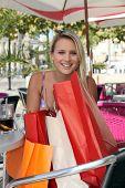 Blonde girl shopping