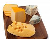 Different Types Of Cheese On Wooden Board
