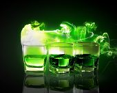 stock photo of absinthe  - Three glasses of green absinth with fairy - JPG