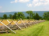 stock photo of battlefield  - Wooden fence on a Civil War Battlefield New Market Virginia - JPG