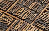 detail of vintage typesetter drawer with  letterpress wood type printing blocks