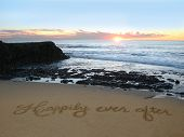 stock photo of prince charming  - Happily Ever After handwritten in the sand - JPG