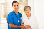 image of scrubs  - senior woman and caring young nurse - JPG