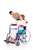 caring daughter talking to disabled senior mother isolated on white