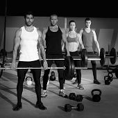 gym group with weight lifting bar workout in exercise