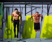 stock photo of dipping  - dip ring two men workout at gym dipping exercise - JPG