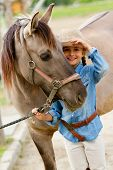 Ranch - Lovely girl with horse on the ranch