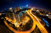 stock photo of klcc  - Fisheye Lens view of Kuala Lumpur City skyline at night - JPG