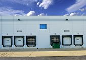stock photo of shipping receiving  - Shipping and Receiving Storage Warehouse Gates - JPG