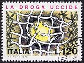 ITALY - CIRCA 1977: a stamp printed in Italy promote a campaign against drugs and addiction. Italy,