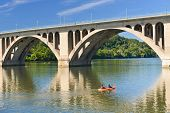 Washington DC,Key Bridge and mirror reflection over Potomac River with kayaking people