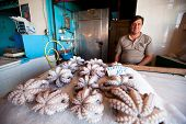 POROS, GREECE - SEP 26: An unidentified seller in market on waterfront in Sep 26, 2012 in Poros, Gre