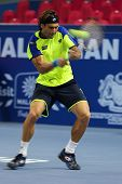 KUALA LUMPUR - SEPTEMBER 27: David Ferrer plays a return to Joao Sousa in a quarter-final match of t