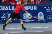 KUALA LUMPUR - SEPTEMBER 27: Stan Wawrinka plays a return to Dimitry Tursunov during a quarter-final