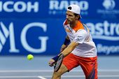 KUALA LUMPUR - SEPTEMBER 28: Jurgen Melzer volleys a return to Joao Sousa in a semi-final match of t