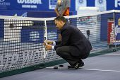 KUALA LUMPUR - SEPTEMBER 28: Umpire Mohamed Lahyani of Sweden measures the net height before the sem